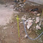 Earth wire connected to earth rod outside property